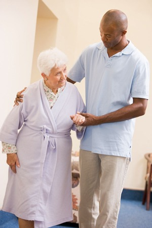home health care resources Nurse Helping Senior Woman To Walk